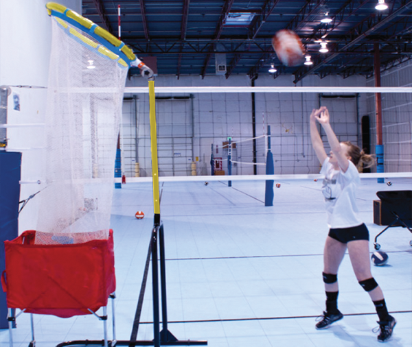 Girl setting volleyball in Precision Volleyball Trainer