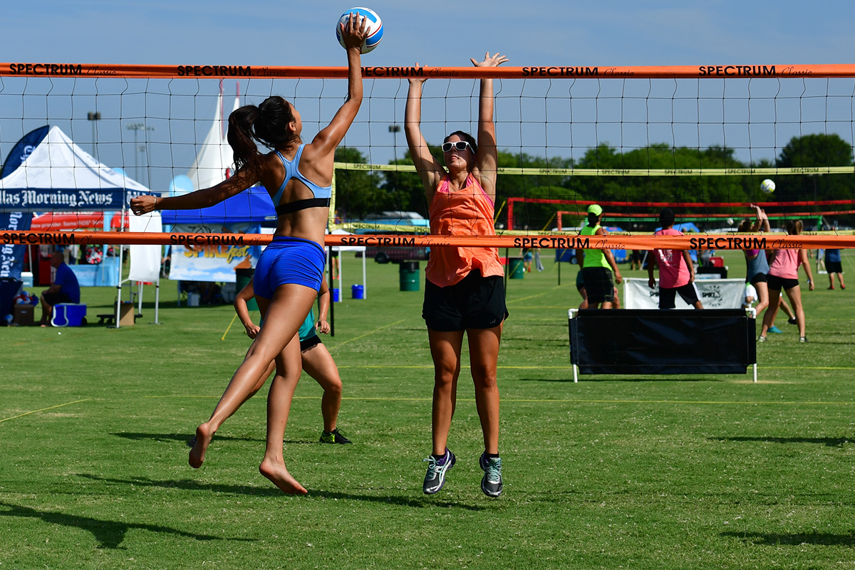 Women's Grass Volleyball playing on Orange Spectrum Classic volleyball set